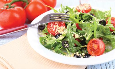 bigstock-Fresh-salad-with-arugula-clos-69598372