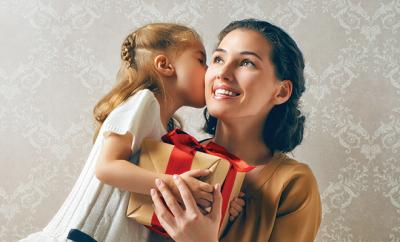 bigstock-happy-family-with-christmas-gi-71967727