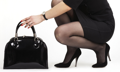 bigstock-Woman-with-black-leather-bag-15603863