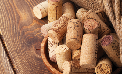 bigstock-Red-wine-bottle-corks-and-cor-91439447